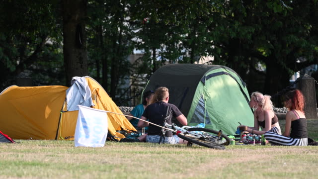 a general view of tents at the extinction rebellion protestors camp outside cardiff city hall as the environmental protest group ends day two of a... - social movement stock videos and b-roll footage