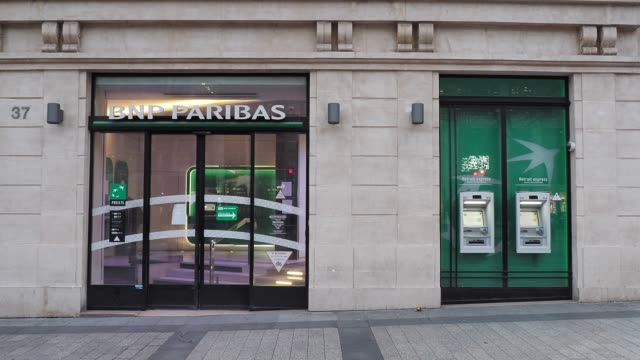 general view of the bnp paribas bank, which is closed to the public, and only available for urgent appointments, at avenue des champs elysees, in the... - bank stock videos & royalty-free footage