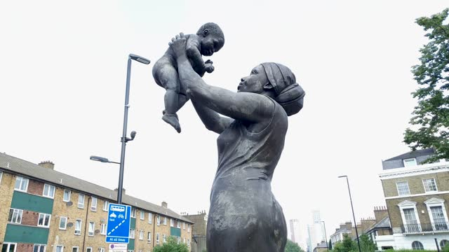 general view of the bronze woman sculpture, unveiled in 2008, which represents the struggles faced by caribbean women and also their contribution to... - london england stock videos & royalty-free footage