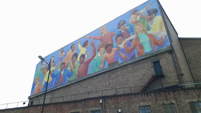 """general view of the """"children at play"""" mural on the back wall of brixton academy on july 2, 2021 in london, england. the mural was created by artist... - messing about stock videos & royalty-free footage"""