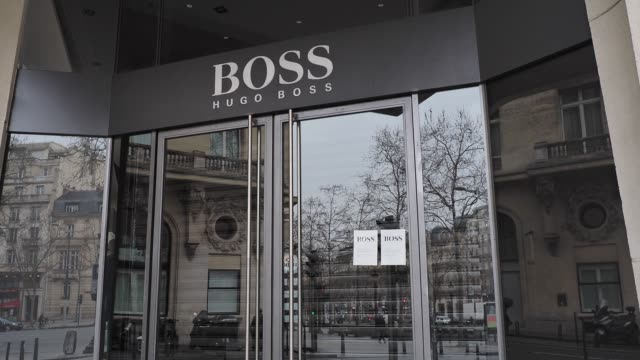 general view of the closed hugo boss store, at avenue des champs elysees, in the 8th quarter of paris, as the city imposes emergency measures to... - hugo boss stock videos & royalty-free footage