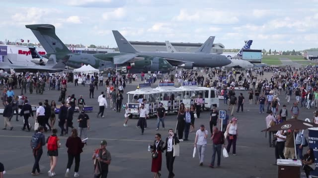 general view of the crowd and the tarmac with the airplanes on display of 53rd paris air show in le bourget airport near the french capital. june 21,... - 2019 stock videos & royalty-free footage