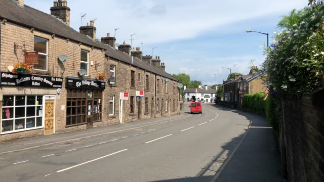 general view of the deserted streets within the closed off village of whaley bridge below toddbrook reservoir, on august 03, 2019 in whaley bridge,... - derbyshire stock-videos und b-roll-filmmaterial