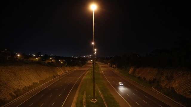 a general view of the eastern freeway as minimal traffic travels along the freeway during curfew on september 10 2020 in melbourne australia... - lockdown stock videos & royalty-free footage