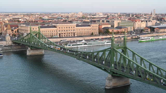 a general view of the liberty bridge and the river danube on october 20 2019 in budapest hungary - river danube video stock e b–roll