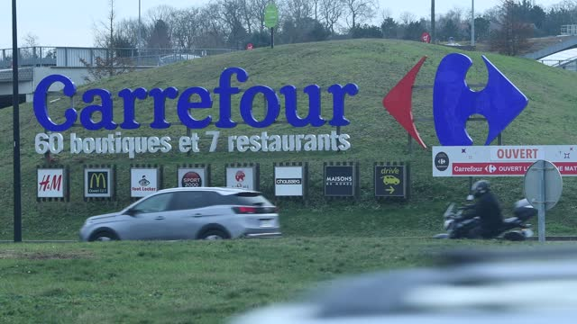 general view of the logo of carrefour department store is seen on february 16, 2021 in chambourcy, france. . - general motors stock videos & royalty-free footage