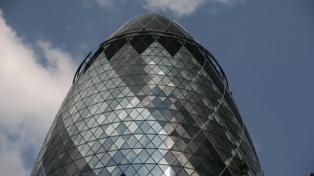 cu general view of the london gherkin building at st mary's axe in the heart of the city shot in london united kingdom on the 30th of april 2014 no - swiss re stock videos & royalty-free footage