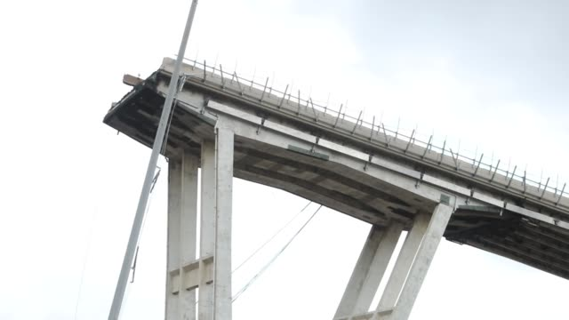 a general view of the morandi bridge which collapsed on august 14 2018 in genoa italy at at least 30 people have died when a large section of morandi... - bridge built structure stock videos and b-roll footage