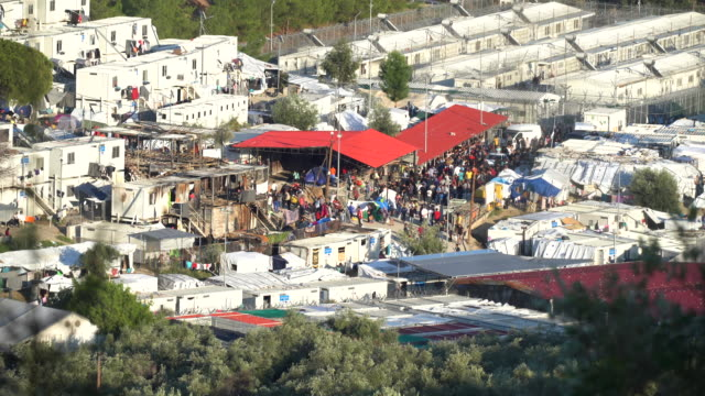 a general view of the moria migrant camp which was built for 3000 people but now contains over 13000 on october 09 2019 in mytilene greece... - flüchtling stock-videos und b-roll-filmmaterial