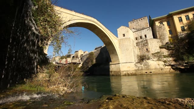 general view of the mostar old bridge 2 - religious symbol stock videos & royalty-free footage