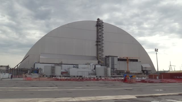 a general view of the new protective shelter over the remains of the nuclear reactor unit 4 at chernobyl nuclear power plant in chernobyl ukraine... - nuclear reactor stock videos and b-roll footage