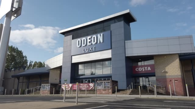 general view of the odeon cinema at the quay on october 6 in glasgow, scotland. odeon cinemas are cutting the opening hours for some of its venues in... - odeon cinemas点の映像素材/bロール