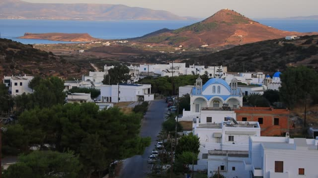 stockvideo's en b-roll-footage met general view of the picturesque village kostos the sea shore as background on august 14 2020 in kostos greece the island of paros has seen increasing... - charmant