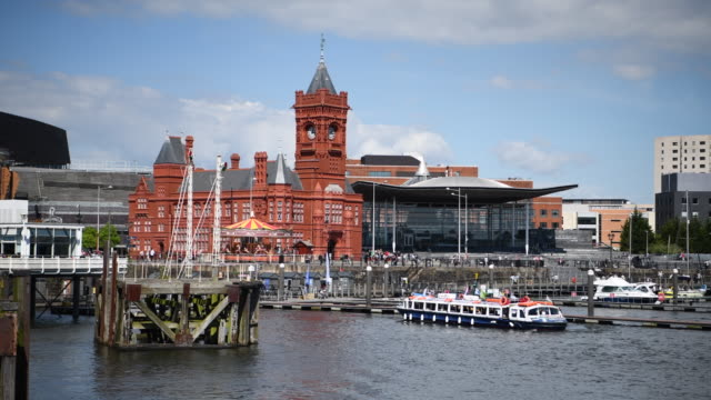vídeos y material grabado en eventos de stock de a general view of the pierhead building and the senedd home of the welsh national assembly at cardiff bay wales uk on a warm summer day - vista general