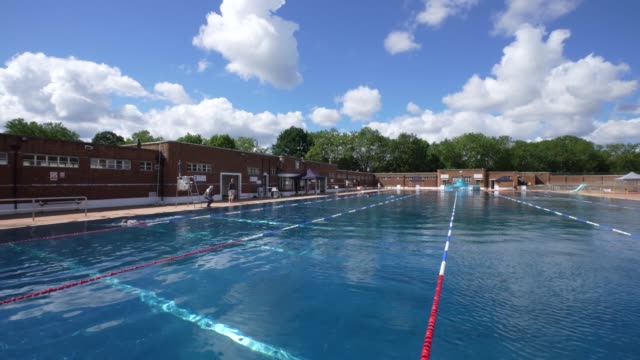 general view of the pool at parliament hill lido as it reopens with social distancing measures in place on july 11, 2020 in london, england. the... - swimming pool stock videos & royalty-free footage