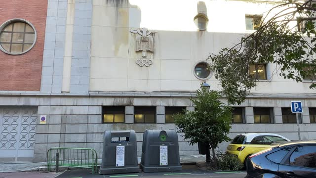general view of the pre-constitutional bas-relief shield on the front of the moscardo municipal sports center on february 10 in madrid, spain. the... - レリーフ点の映像素材/bロール