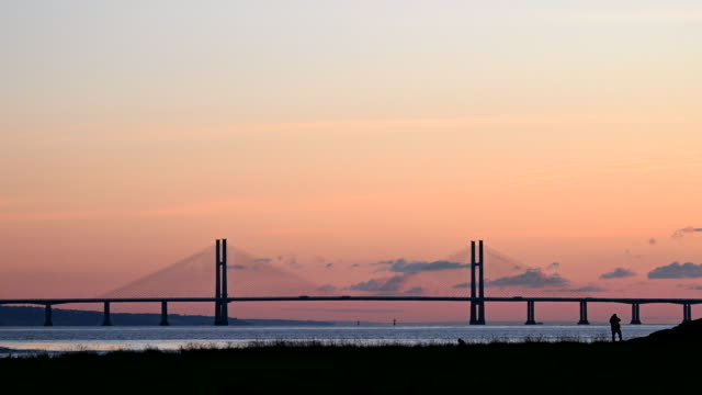 general view of the prince of wales bridge which links england and wales via the m4 and is formerly known as the second severn crossing, at sunset on... - gold coloured stock videos & royalty-free footage