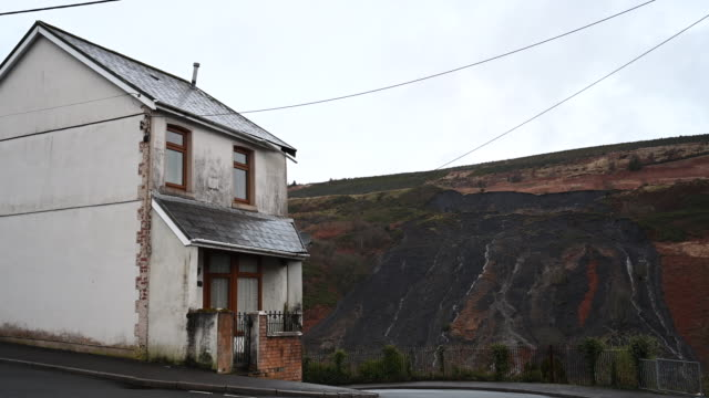 general view of the scene of a landslide in the rhondda valley on february 18 in tylorstown, wales. inspections of old coal tips on the mountains in... - fossil fuel stock videos & royalty-free footage