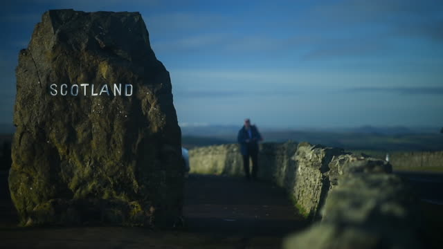 general view of the scotland signs on the a68 at carter bar near jedburgh, scotland on november 23 2016. - ジェドバラ点の映像素材/bロール