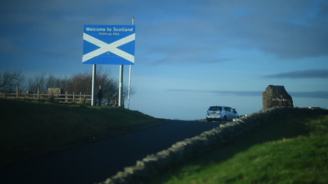 general view of the scotland signs on the a68 on november 23 2016 in jedburgh, scotland. - ジェドバラ点の映像素材/bロール