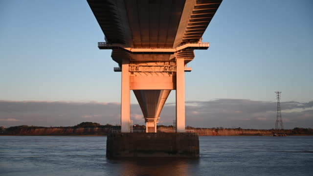 general view of the severn bridge which links wales and england via the m48, at sunset on october 15 in beachley, england. the welsh first minister... - directly below stock videos & royalty-free footage