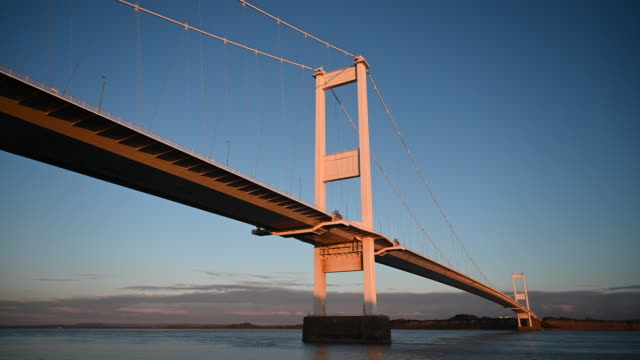 general view of the severn bridge which links wales and england via the m48, at sunset on october 15 in beachley, england. the welsh first minister... - gold coloured stock videos & royalty-free footage