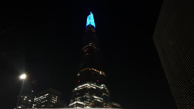 general view of the shard, illuminated with visual effects in shades of blue and white, specially designed to show gratitude to all nhs staff and key... - blue stock videos & royalty-free footage