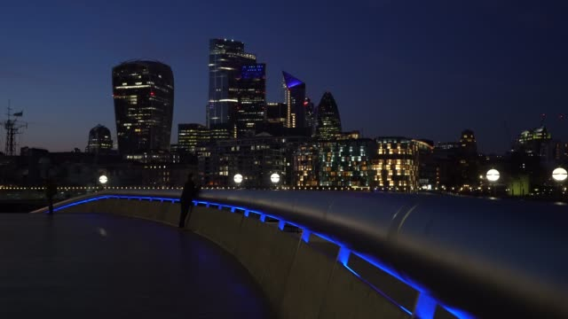 general view of the skyline of the city of london as uk landmarks and buildings by turning the lights blue as part of the #clapforourcarers and the... - skyline stock videos & royalty-free footage