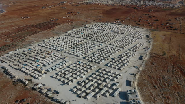 general view of the turkish red crescents camp near the village of atmeh that hosts nearly 1 million displaced syrians near the syrian-turkish border... - refugee stock videos & royalty-free footage