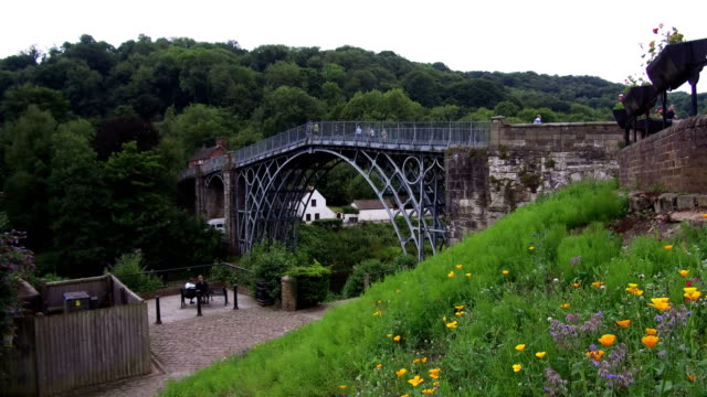 a general view of the unesco world heritage site of ironbridge on june 21 ironbridge england the world's first cast iron bridge was built over the... - bridge built structure stock videos & royalty-free footage
