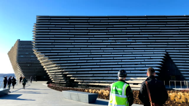 general view of the v&a museum, as japanese architect kengo kuma and designer of the building visits the building on february 9, 2018 in dundee,... - スコットランド ダンディー点の映像素材/bロール