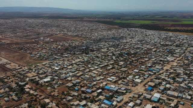 a general view of the village of atmeh that hosts nearly 1 million displaced syrians near the syrianturkish border in idlib province september 17... - flüchtlingslager stock-videos und b-roll-filmmaterial