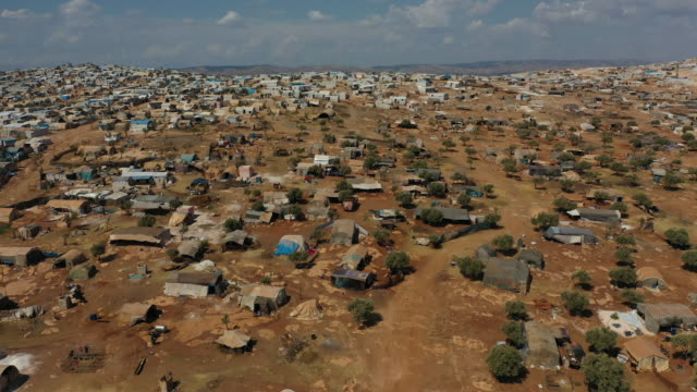 a general view of the village of atmeh that hosts nearly 1 million displaced syrians near the syrianturkish border in idlib province september 17... - refugee camp stock videos & royalty-free footage