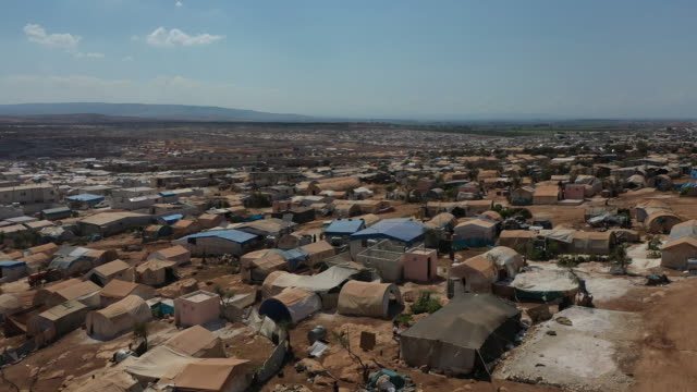 a general view of the village of atmeh that hosts nearly 1 million displaced syrians near the syrianturkish border in idlib province september 17... - hatay stock videos & royalty-free footage