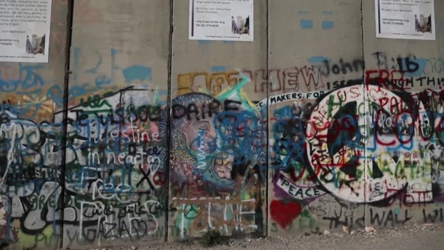 general view of the 'walled off hotel' by british street artist banksy which is located just opposite israel's separation wall on march 11 in... - israele video stock e b–roll