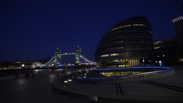 general view of tower bridge and city hall as uk landmarks and buildings by turning the lights blue as part of the #clapforourcarers and the... - tower bridge stock videos & royalty-free footage