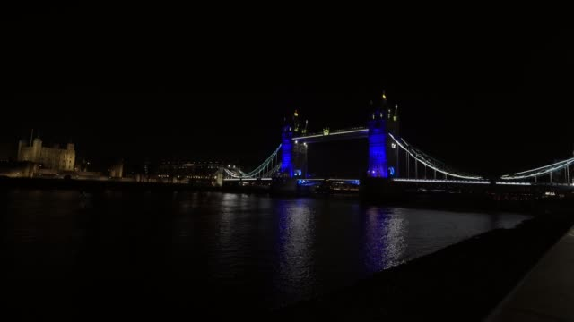 general view of tower bridge as uk landmarks and buildings by turning the lights blue as part of the #clapforourcarers and the #lightitbluecampaign... - turning stock videos & royalty-free footage