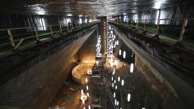 general view of turda salt mine - mineral stock-videos und b-roll-filmmaterial