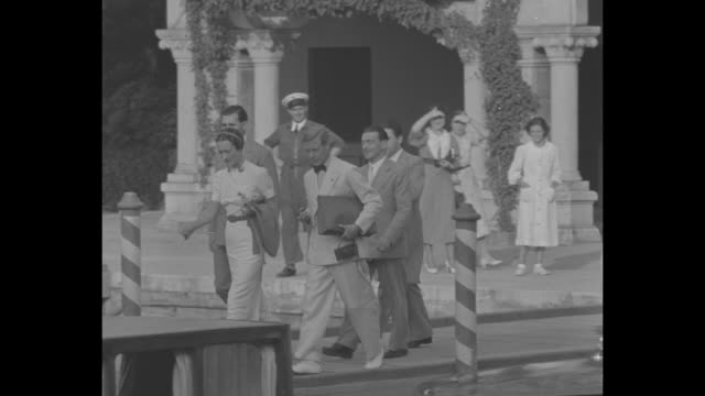 general view of venice resort / duke and duchess of windsor tour property / duke and duchess sunbathe on beach / note exact day not known - wallis simpson stock videos & royalty-free footage