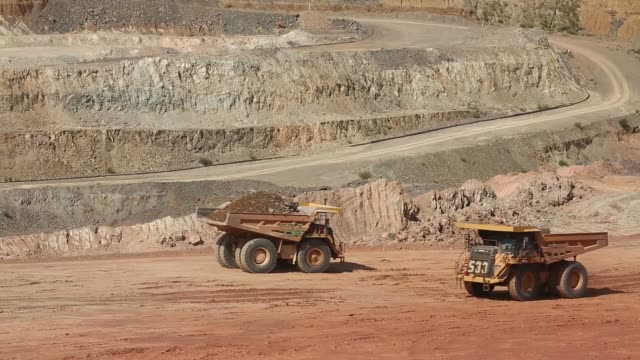 General view open air gold mine operated by Randgold Resources Ltd in Gounkoto Mali on Friday Nov 1 A bulldozer reverses on digging floor A dumper...