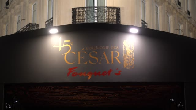 stockvideo's en b-roll-footage met general view outside the dinner at le fouquet's as part of the cesar film awards 2020 while feminist activists protest against the nominations of... - roman polanski