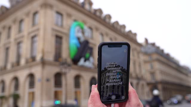 "general view outside the louis vuitton maison vendôme store, where the cartoon characters designed by virgil abloh, ""zoooom et ses amis"" are... - mobile phone stock videos & royalty-free footage"