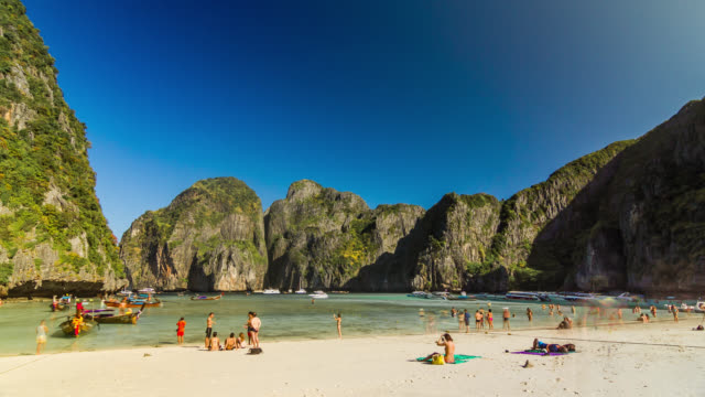 General view timelapse of the Maya bay beach with tourists on Phi Phi Ley Island, Thailand. January, 2016.