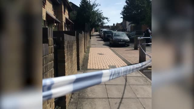 general views a 15-year-old boy is in a critical condition after being stabbed in haringey, north london. police received reports of a stabbing at... - 刺傷事件点の映像素材/bロール