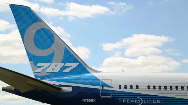 general views a 787 logo sits on the tail fin of a boeing 7879 dreamliner aircraft produced by boeing co as it stands on display on the first day of... - boeing 787 stock videos and b-roll footage