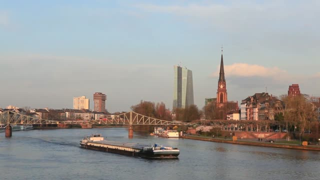 General views a cargo barge sails along the River Main in Frankfurt Germany on Monday March 24 The European Central Banks new headquarters stand on...