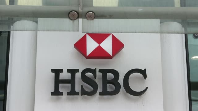 General views a logo sits on a sign outside a HSBC Holdings Plc bank branch in London UK on Friday May 2 General views signage above entrance to bank...