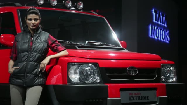 general views a woman poses by a tata motors ltd sumo extreme concept sportutility vehicles at the 12th auto expo 2014 in noida india on friday feb 7... - safari india stock videos and b-roll footage