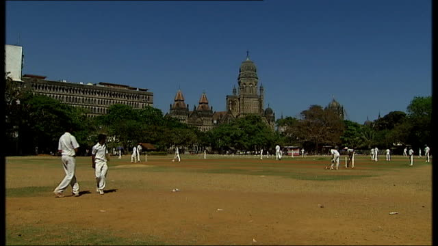 general views and cricket practice in mumbai; cricket match in progress on pitch / practice shots taken from behind stumps and nets - cricket stump stock videos & royalty-free footage
