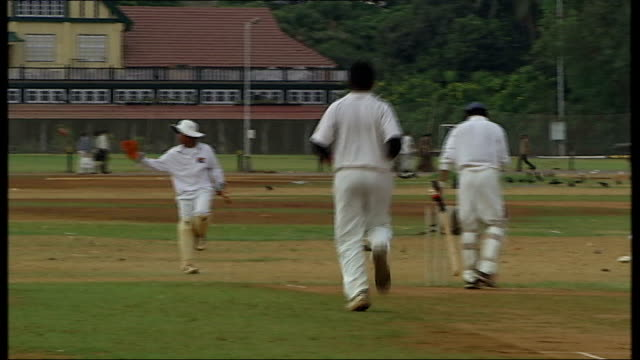 General views and cricket practice in Mumbai Players onto pitch for match / Varous matchplay